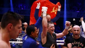 Chudinov of Russia reacts after winning his super - middleweight WBA world championship title fight against Germany's Felix Sturm in Frankfurt
