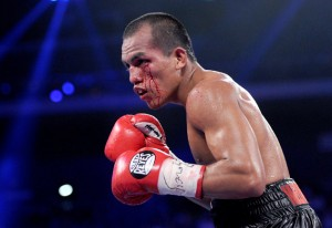 Philippines' Milan Melindo competes against Mexico's Juan Francisco Estrada during a WBO WBA flyweight title fight bout in Macau on July 27, 2013. Estrada defended his title by winning on a points decision. AFP PHOTO / Dale de la Rey        (Photo credit should read DALE de la REY/AFP/Getty Images)