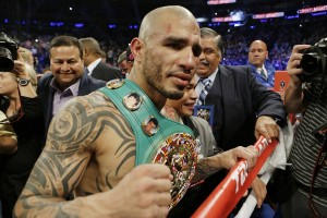 Miguel Cotto, of Puerto Rico, reacts after winning a WBC World Middleweight Title boxing match against Sergio Martinez, of Argentina, Sunday, June 8, 2014, in New York.  Cotto won by technical knockout after the ninth round. (AP Photo/Frank Franklin II)