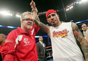 Oct.5, 2013, Orlando,Florida --- Three-time world champion Miguel Cotto(R)gets his hands raised by trainer Freddie Roach(L) after he  stops  Delvin Rodriguez  in the 3rd round,  Saturday at the Amway Center in Orlando, Florida.  --- Photo Credit : Chris Farina - Top Rank (no other credit allowed) copyright 2013
