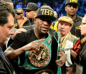 Sep 13, 2014; Las Vegas, NV, USA; Floyd Mayweather celebrates in the ring after defeating Marcos Maidana (not pictured) in their WBC & WBA Welterweight and WBC Superwelter Weight title fight at the MGM Grand Garden Arena. Mandatory Credit: Jayne Kamin-Oncea-USA TODAY Sports ORG XMIT: USATSI-188696 ORIG FILE ID:  20140913_jla_aj4_916.jpg