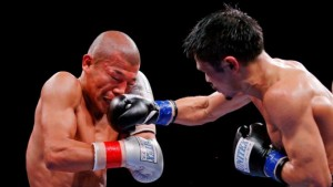 CHICAGO, IL - OCTOBER 16: Kohei Kono (R) throws a right at at Koki Kameda during their the WBA-Super Flyweight Attraction fight at UIC Pavilion on October 16, 2015 in Chicago, Illinois. Kohei Kono won by unanimous decision. (Photo by Jon Durr/Getty Images)