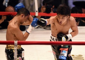 WBO super flyweight champion Naoya Inoue of Japan (R) punches challenger Warlito Parrenas of Philippines (L) during their boxing title bout in Tokyo on December 29, 2015.        AFP PHOTO / TOSHIFUMI KITAMURA