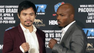 Manny Pacquiao, left, and Timothy Bradley Jr. pose during a news conference in Beverly Hills, Calif., on Tuesday, Jan. 19, 2016. Pacquiao and Bradley are scheduled to fight on April 9, 2016, in Las Vegas for Bradley's WBO welterweight title. (AP Photo/Nick Ut)