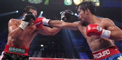 Pacquiao vence a Márquez en cerrado combate